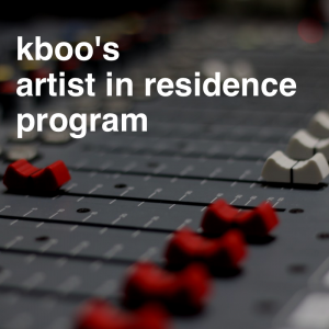 """Close up of red and white potentiometers on a soundboard with overlaying text that reads """"kboo's artist in residence program"""""""