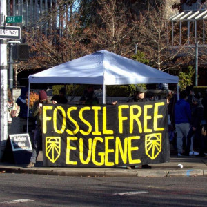 "A banner reading ""Fossil Free Eugene"""
